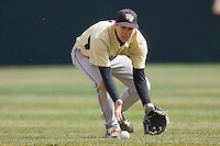 Second baseman Mark Rhine #2 of the Wake Forest Demon Deacons corrals a ground ball in short right field at English Field March 27, 2010, in Blacksburg, Virginia.  Photo by Brian Westerholt / Four Seam Images