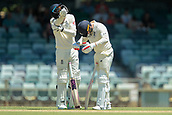 November 4th 2017, WACA Ground, Perth Australia; International cricket tour, Western Australia versus England, day 1; English batsmen James Vince (L) and Mark Stoneman (R) drain the sweat out of their helmets during their partnership on day 1 against Western Australia