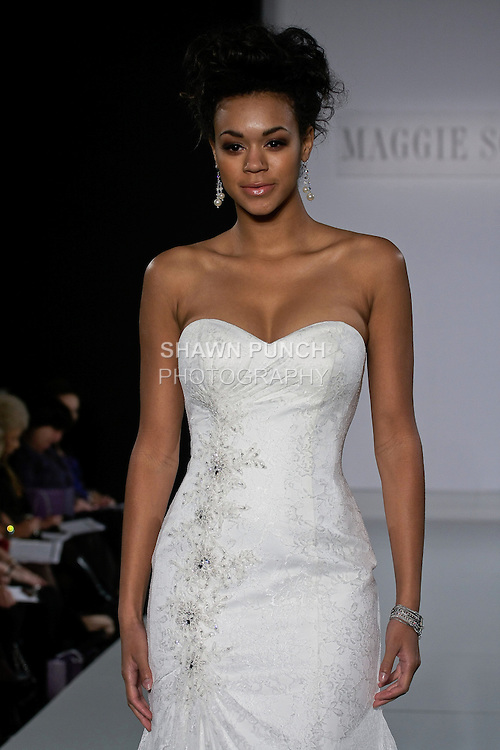 Model walks runway in an Everett wedding gown from the Maggie Sottero Spring 2013 collection, at The Couture Show, during New York Bridal Fashion Week, on October 14, 2012.