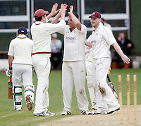 Tony Duckett (C) enjoys some high fives after dismissing B Hackshall during the Middlesex County Cricket League Division Three game between North London and Highgate at Park Road, Crouch End, London on Sat May 29, 2010