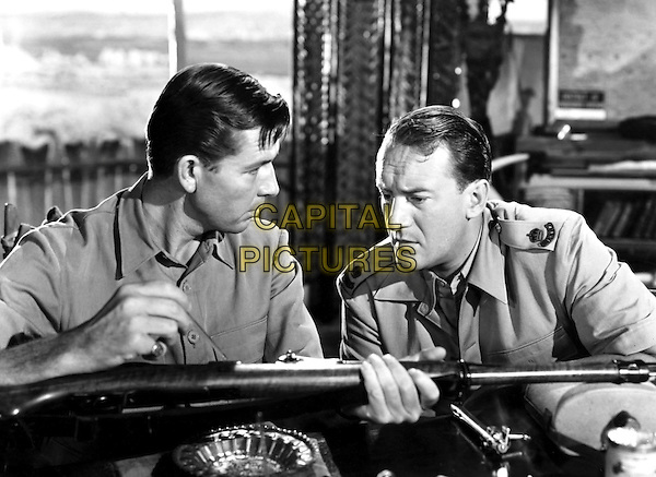 Bruce Cabot, George Sanders.in Sundown (1941) .*Filmstill - Editorial Use Only*.CAP/NFS.Supplied by Capital Pictures.