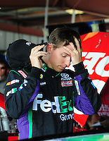 May 1, 2009; Richmond, VA, USA; NASCAR Sprint Cup Series driver Denny Hamlin reacts during practice for the Russ Friedman 400 at the Richmond International Raceway. Mandatory Credit: Mark J. Rebilas-
