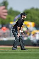 Umpire Phil Bando handles the calls on the bases during the Pioneer League game between the Missoula Osprey and the Billings Mustangs at Dehler Park on August 20, 2017 in Billings, Montana.  The Osprey defeated the Mustangs 6-4.  (Brian Westerholt/Four Seam Images)