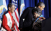 """United States President Barack Obama poses with Hartford and Mary Black Eagle, his Crow nation """"parents"""" who """"adopted"""" him during the 2008 campaign, after speaking at the White House Tribal Nations Conference at the U.S. Department of the Interior, Friday, December 2, 2011 in Washington, DC. The purpose of the conference is to continue to strengthening the government-to-government relationship between the United States and tribal governments..Credit: Olivier Douliery / Pool via CNP"""