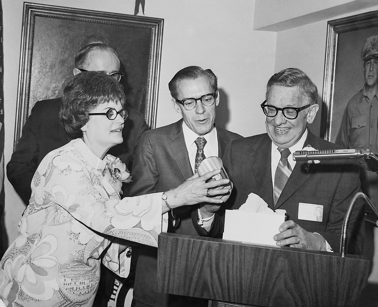 "Rep. William S. ""Bill"" Broomfield, R-Mich., House of Representatives Member, and Mrs. Marlette standing with party member. (Photo by CQ Roll Call)"