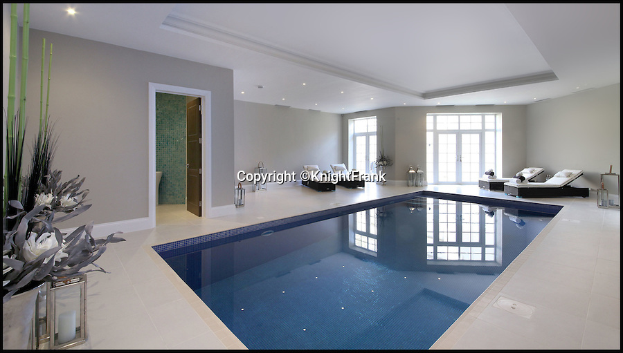 BNPS.co.uk (01202 558833)<br /> Pic: KnightFrank/BNPS<br /> <br /> Bolthole-in-one!<br /> <br /> Swimming pool complex with sauna and spa.<br /> <br /> Golf fans will be green with envy - This brand new Palladian style pad comes with a fantastic view of the 17th green at exclusive Wentworth golf club in Surrey.<br /> <br /> But despite the £6.75 million price tag you will still have to pass muster with the members and stump up a £125,000 joining fee to become part of the world famous club.<br /> <br /> Greenside is part of the Wentworth Estate, one of the most expensive private estates in the country, which has the Wentworth Golf Club at its heart.<br /> <br /> The lucky buyer of this house can watch the world's best golfers battle it out for the European Tour's PGA Championship from the balcony overlooking the 17th green of the iconic West Course.<br /> <br /> The newly-built five-bedroom home, on the market with Knight Frank, has everything you could need, including an indoor swimming pool complex with a sauna and a spa.