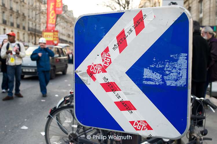 Hospital in danger stickers on a road sign as marchers in Paris join up to 3 million people across France during a national strike against the Sarkozy government's economic policies.