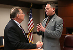 Gov. Brian Sandoval's Chief of Staff Mike Willden, left, talks with Assemblyman Mike Sprinkle, D-Sparks, following a committee hearing at the Legislative Building in Carson City, Nev., on Tuesday, Feb. 3, 2015. <br /> Photo by Cathleen Allison