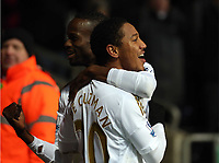 Saturday 19 January 2013<br /> Pictured: Jonathan de Guzman (R) of Swansea celebrating his second goal with team mate Roland Lamah (L).<br /> Re: Barclay's Premier League, Swansea City FC v Stoke City at the Liberty Stadium, south Wales.