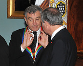 Washington, DC - December 5, 2009 -- 2009 Kennedy Center honoree Robert De Niro engages in conversation with an unidentified person as he and the other honorees prepare to pose for the formal group photo following the Artist's Dinner at the United States Department of State in Washington, D.C. on Saturday, December 5, 2009.  .Credit: Ron Sachs - Pool via CNP