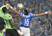 BOGOTA - COLOMBIA -27 -11-2016: Ayron del Valle (Der) jugador de Millonarios salta por el balón con Rodin Quiñonez (Izq) jugador de Atlético Nacional durante partido de ida por los cuartos de final de la Liga Aguila II 2016 jugado en el estadio Nemesio Camacho El Campin de la ciudad de Bogota./ Ayron del Valle (R) player of Millonarios fights for the ball with Rodin Quiñonez (L) player of Atletico Nacional during first leg match for the final quarters of the Liga Aguila II 2016 played at the Nemesio Camacho El Campin Stadium in Bogota city. Photo: VizzorImage / Gabriel Aponte / Staff.