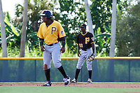 Pittsburgh Pirates shortstop Victor Ngoepe (60) plays defense behind his brother Gift Ngoepe (91) leading off second base during an Instructional League Intrasquad Black & Gold game on September 21, 2016 at Pirate City in Bradenton, Florida.  (Mike Janes/Four Seam Images)