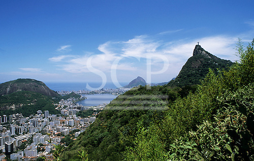 Rio de Janeiro, Brazil. View of the Christ Statue and Corcovado mountain with the city of Rio and the ocean below.