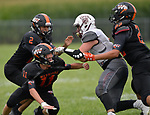 Wesclin players (from left) Kaleb Williams, Connor Bridick, and Josh Serrano combined to tackle Dupo quarterback C.J. Robinson. Wesclin defeated Dupo 34-30 on Saturday August 31, 2019 in a game that was stopped Friday night at halftime due to storms. <br /> Tim Vizer/Special to STLhighschoolsports.com