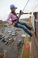 NWA Democrat-Gazette/BEN GOFF @NWABENGOFF<br /> Rubianne Rubio of Bella Vista steps takes her turn Saturday, March 11, 2017, during the Sunshine School &amp; Development Center's rappelling fundraiser with Over The Edge at the 8W Center in Bentonville. The school began a campaign in January, with participants who reached their fundraising goal able to participate in rappelling from the roof of the 6-story building. Over the Edge is a company which specializes in producing events for non profits using equipment and techniques used in commercial rope-access work such as sign installation and window washing. The event had raised more than $57,000 for the school, with more donations still coming in Saturday morning. Located in Rogers, the Sunshine School &amp; Development Center serves children and adults with developmental dissabilities, including a preschool.
