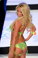 Miami Dolphins Cheerleader, Carissa, walks runway at Miami Dolphins Cheerleaders 2013 Swimsuit Calendar Unveiling Fashion Show at LIV Nightclub in The Fontainebleau Miami Beach Hotel, Miami Beach, FL on August 26, 2012