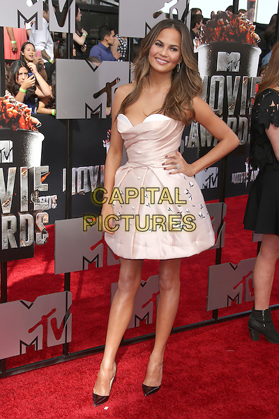 LOS ANGELES, CA - APRIL 13: Christine Teigen at the 2014 MTV Movie Awards at Nokia Theatre L.A. Live on April 13, 2014 in Los Angeles, California. <br /> CAP/MPI/JO<br /> &copy;Janice Ogata/MPI/Capital Pictures