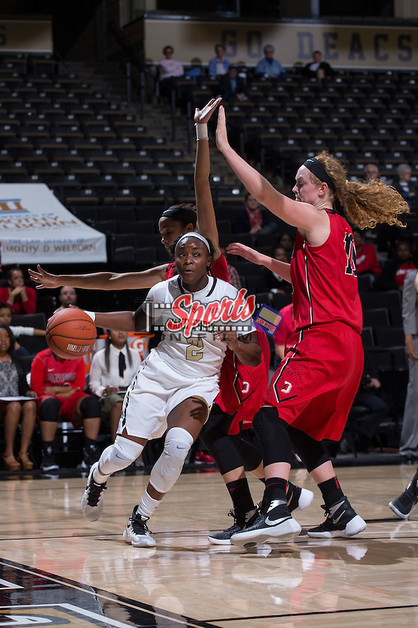 Amber Campbell (2) of the Wake Forest Demon Deacons drives the lane past Hannah Early (10) of the Davidson Wildcats during first half action at the LJVM Coliseum on November 17, 2015 in Winston-Salem, North Carolina.  The Demon Deacons defeated the Wildcats 77-58.  (Brian Westerholt/Sports On Film)