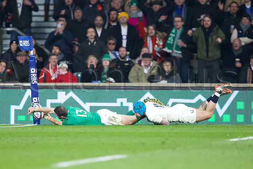 27.02.2016. Twickenham, London, England. RBS Six Nations Championships. England versus Ireland. Ireland centre Robbie Henshaw is taken  into touch by England wing Jack Nowell and doesn't get the try.