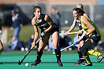 14 November 2015: Wake Forest's Jessy Silfer (4) and Michigan's Allie Sardo (right). The Wake Forest University Demon Deacons played the University of Michigan Wolverines at Francis E. Henry Stadium in Chapel Hill, North Carolina in a 2015 NCAA Division I Field Hockey Tournament First Round match. Michigan won the game 2-1.