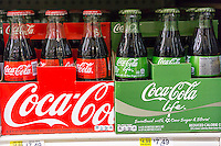 Six-packs of mini-bottles of the new Coca-Cola Life and Classic Coke in a supermarket in New York on Tuesday, November 25, 2014.  The 60-calorie drink is sweetened with cane sugar and Stevia. The product appears to be popular with stores selling out with customers liking the taste and the green labeling. Previously the only way to get Coke made with cane sugar in the United States was to purchase imported Mexican bottled Coke or to buy the Kosher for Passover product (dietary laws prevent corn syrup being used).  (© Richard B. Levine)