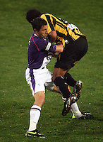 Perth captain Jacob Burns fouls Paul Ifill during the A-League football match between Wellington Phoenix and Perth Glory at Westpac Stadium, Wellington, New Zealand on Sunday, 16 August 2009. Photo: Dave Lintott / lintottphoto.co.nz