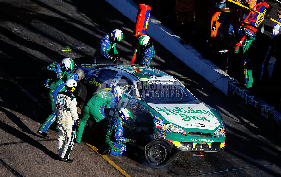 Nov. 8, 2008; Avondale, AZ, USA; NASCAR Nationwide Series driver Scott Wimmer pits after blowing a tire during the Hefty Odor Block 200 at Phoenix International Raceway. Mandatory Credit: Mark J. Rebilas-