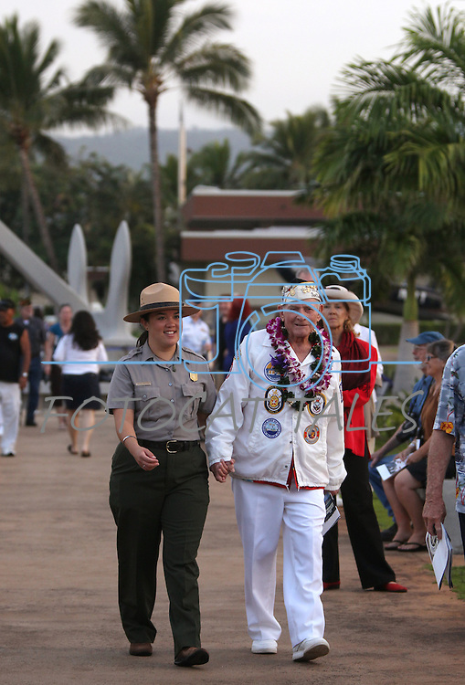 National Parks worker Alycia Anderson escorts Pearl Harbor survivor Woodrow W. Derby to his seat before the 71st Anniversary Pearl Harbor Day Commemoration at the Pearl Harbor Visitor Center in Honolulu, HI on, Dec. 7, 2012. .Photo by Cathleen Allison