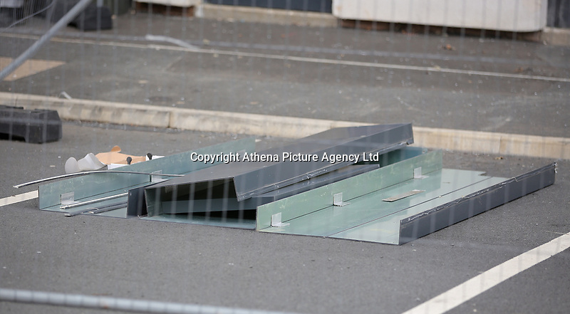 Pictured: Cladding panels on the ground after being removed from Kennedy Gardens flats in Billingham. Tuesday 27 June 2017<br /> Re: Cladding is being removed by workers from the fascia of high-rise flats at Kennedy Gardens in Billingham, County Durham, England, UK