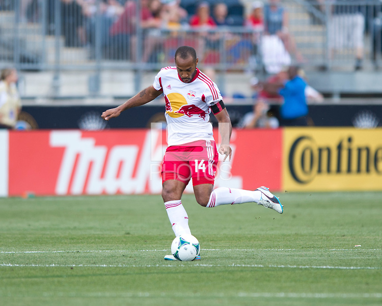 Thierry Henry (14) of the New York Red Bulls passes the ball forward during a Major League Soccer game at PPL Park in Chester, PA.  Philadelphia defeated New York, 3-0.