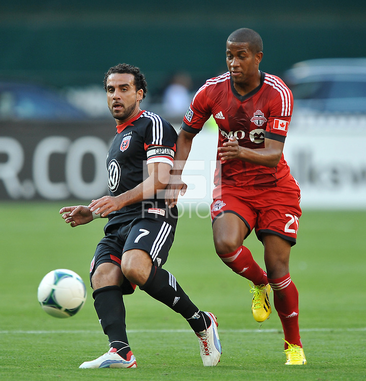 Dwayne De Rosario (22) of D.C. United goes against Alan Rochat (25) of Toronto FC. Toronto FC defeated D.C. United 2-1, at RFK Stadium, Saturday June 15 , 2013.