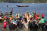 Canoe Journey, Paddle to Nisqually, 2016, Northwest tribal canoes arriving in Olympia, l-r Owyano-Spirit Canoe Family, Nanaimo tribe, Cowichan tribe, Washington, 7-30-2016, Salish Sea, Puget Sound, Washington State, USA,