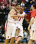 March 9, 2012; Indianapolis, IN, USA; Wisconsin Badgers guard Rob Wilson (33) is congratulated by teammate Jordan Taylor (11) during a Big Ten Confierence tournament quarterfinal game against the Indiana Hoosiers at Bankers Life Fieldhouse. (Photo by Bob Campbell)