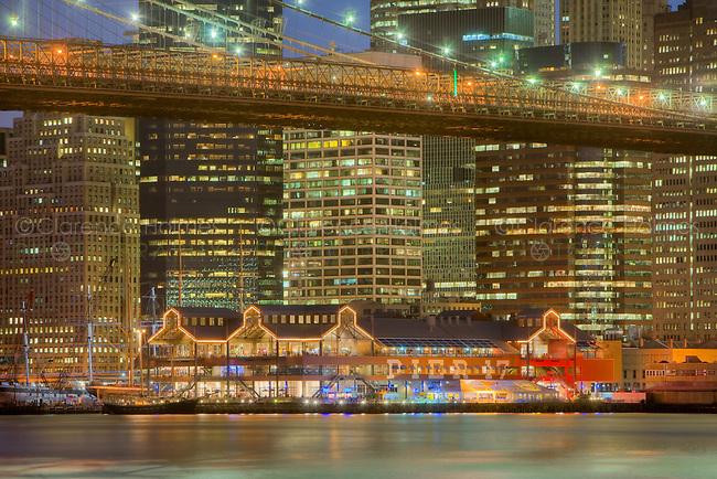 Brooklyn Bridge, East River, South Street Seaport, and lower Manhattan skyline at twilight, as seen from Brooklyn Bridge Park