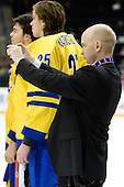 Stefan Ladhe (Sweden - Assistant Coach) - Team Sweden celebrates after defeating Team Switzerland 11-4 to win the bronze medal in the 2010 World Juniors tournament on Tuesday, January 5, 2010, at the Credit Union Centre in Saskatoon, Saskatchewan.