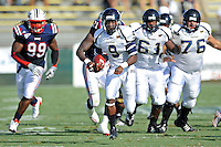 30 October 2010:  FIU running back Kedrick Rhodes (9) carries the ball in the first quarter as the Florida Atlantic University Owls defeated the FIU Golden Panthers, 21-9, at Lockhart Stadium in Fort Lauderdale, Florida.