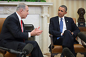 "United States President Barack Obama, right, looks on as Prime Minister Benjamin Netanyahu of Israel speaks in the Oval Office of the White House in Washington, D.C., U.S., on Monday, March 3, 2014. Obama urged Netanyahu to ""seize the moment"" to make peace, saying time is running out to negotiate an Israeli-Palestinian agreement. <br /> Credit: Andrew Harrer / Pool via CNP"