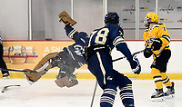 George Washington goalie Alec Astorga's feet fly out from under him after coming out from the goal crease to poke check George Mason's Cameron Smith (74). George Mason defeated George Washington 5-2 on 9-22-18.<br />