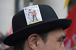 Credit Crunch protest outside bank of England Threadneedle Street. Stop the City march and demonstration against capitalism April 1st  2009. Man wears Bowler hat a symbol of the city and a Joker plying card in the hat band.