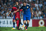(R) Gonzalo Higuain is followed by (L) Fofo Wisdom Agbo of Hong Kong during the HKFA Centennial Celebration Match between Hong Kong vs Argentina at the Hong Kong Stadium on 14th October 2014 in Hong Kong, China. Photo by Aitor Alcalde / Power Sport Images