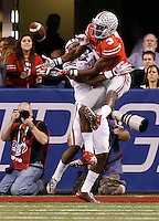 Ohio State Buckeyes wide receiver Michael Thomas (3) can't haul in a pass defended by Wisconsin Badgers cornerback Darius Hillary (5) during the third quarter of the Big Ten Championship game at Lucas Oil Stadium in Indianapolis on Dec. 6, 2014. Hillary was called for pass interference on the play. (Adam Cairns / The Columbus Dispatch)