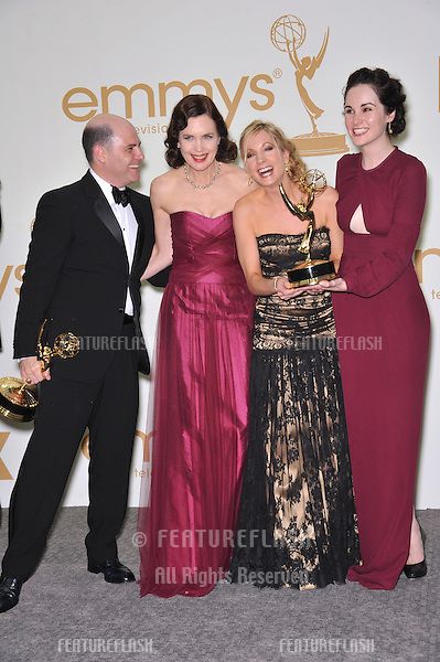 Downton Abbey stars Elizabeth McGovern (left), Joanne Froggatt & Michelle Dockery with Mad Men creator Matthew Weiner in the press room at the 2011 Primetime Emmy Awards at the Nokia Theatre L.A. Live in downtown Los Angeles..September 18, 2011  Los Angeles, CA.Picture: Paul Smith / Featureflash