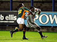Photo: Richard Lane/Richard Lane Photography. England U20 v South Africa U20. Semi Final. 18/06/2008. England's Miles Benjamin is tackled by South Africa's Vainon Willis.