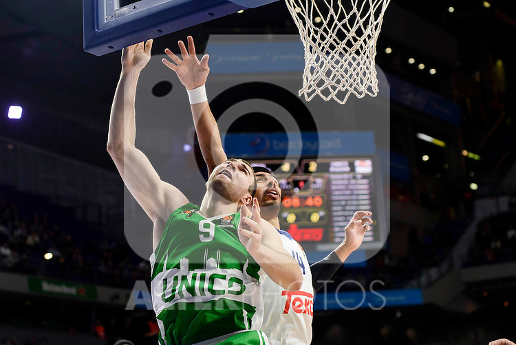 Real Madrid's player Gustavo Ayon and Unics Kazan's player Artsiom Parakhouski during match of Turkish Airlines Euroleague at Barclaycard Center in Madrid. November 24, Spain. 2016. (ALTERPHOTOS/BorjaB.Hojas)