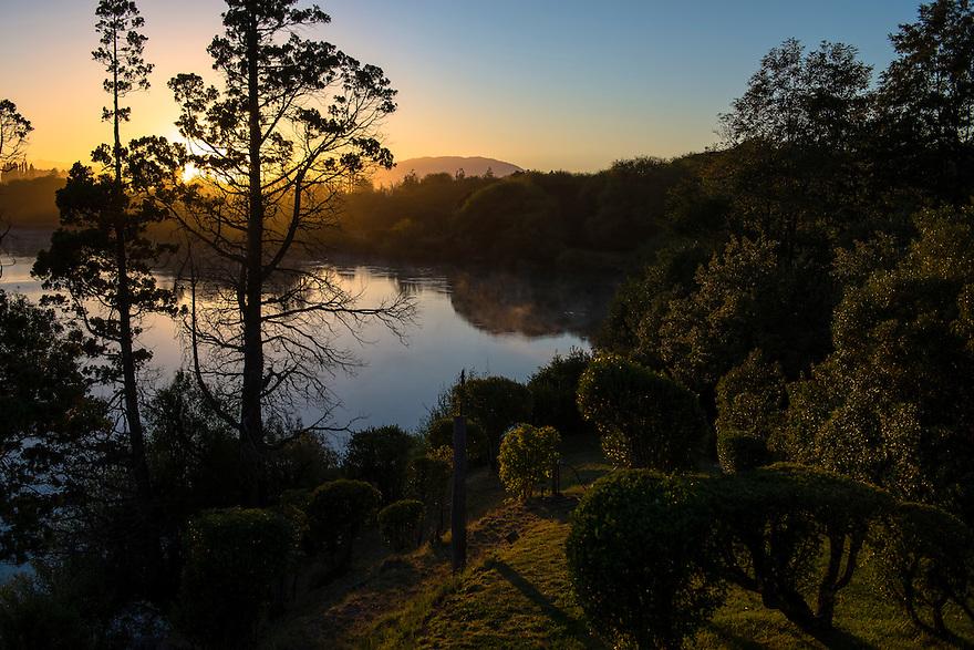 The sun sires on the Rio Futaleufú near Esquel, Argentina.