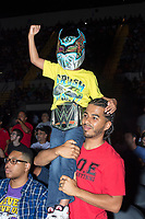 "David Lopez, 32, of Springfield, Mass., (in red) holds his son David Lopez, Jr., 7, during a WWE Live Summerslam Heatwave Tour event at the MassMutual Center in Springfield, Massachusetts, USA, on Mon., Aug. 14, 2017. David Lopez, Jr., wore a mask similar to those worn by WWE superstar Sin Cara, who wears Lucha Libre-style masks. David Lopez (the father) said it was his son's first wrestling match. ""I remember my dad doing this [with me],"" he said."