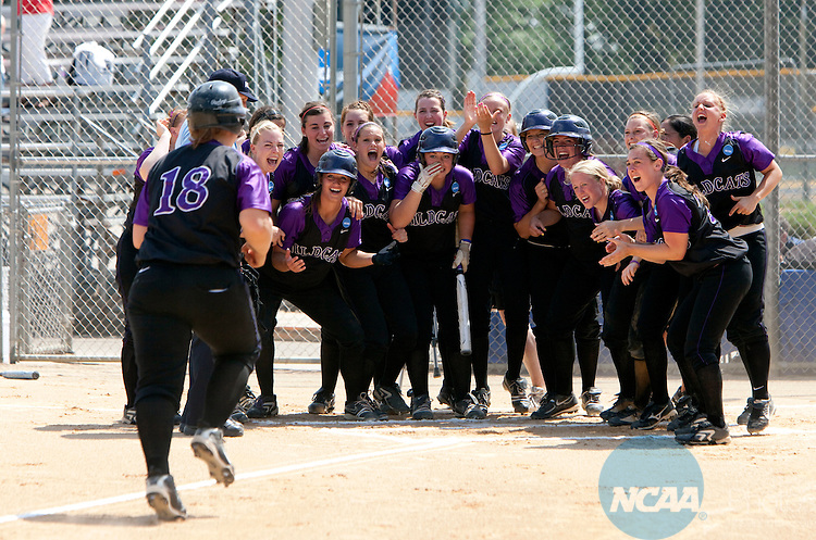 24 MAY 2010:  Linfield College players welcome home Staci Doucette (18) after a two-run home run in the first inning against East Texas Baptist University during the 2010 Division III Softball Championship at Carson Park in Eau Claire, WI. ETBU scored two runs in the bottom of the seventh inning to defeat Linfield College 5-4 for the championship. .Jeff Thompson/ NCAA Photos..