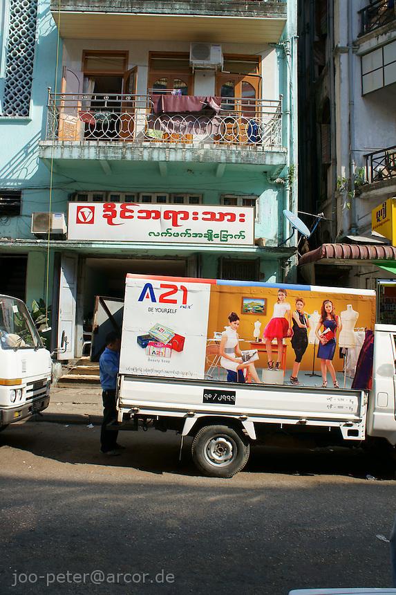 street scene with modern building,  Yangon, Myanmar, 2011