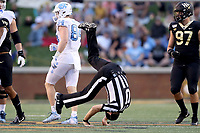 WINSTON-SALEM, NC - SEPTEMBER 13: Umpire Danny Worrell does a summersault after tripping during a game between University of North Carolina and Wake Forest University at BB
