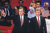 United States Vice President George H.W. Bush, left, and U.S. Senator Dan Quayle (Republican of Indiana), center, on the podium after delivering their speeches accepting their party's nomination for President and Vice President of the United States respectively at the 1988 Republican Convention at the Super Dome in New Orleans, Louisiana on August 18, 1988. <br /> Credit: Arnie Sachs / CNP